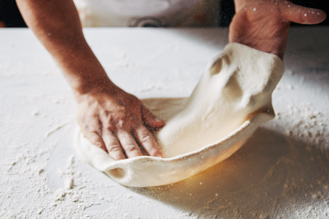 Rolling Dough To Make Pizza
