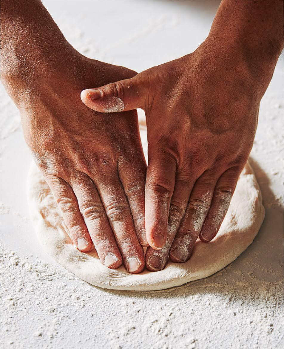 Via Napoli Rolling A Dough For Pizza